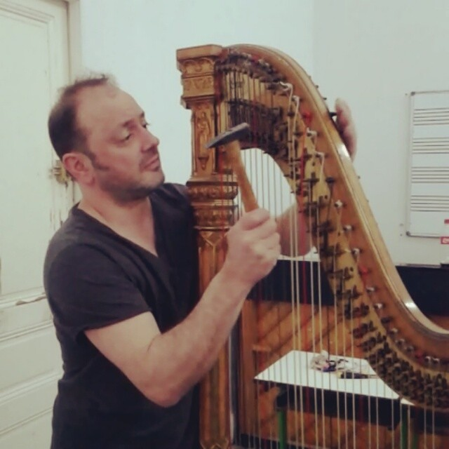 Disassembling the harp before restoration. I tried to play it cool and not cry.