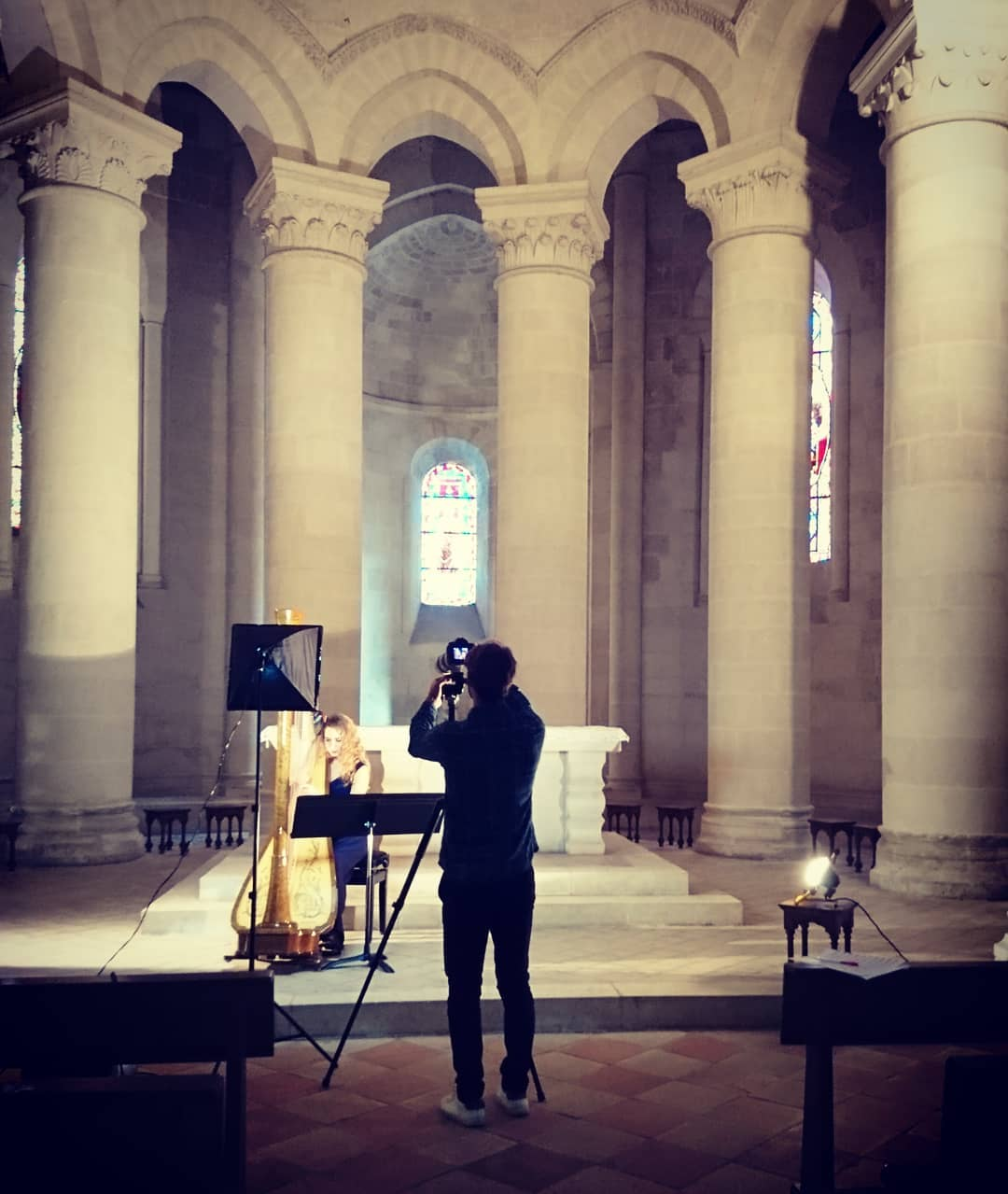 """My new video, """"Concerto pour une voix"""" is out!! 🤩 Here's a little from the shoot (trying to find a way to decently light the gorgeous yet MASSIVE Abbey of with our 3 little spots)! 🤗 Check out the result on Youtube (like in bio), and please don't hesitate to leave a comment to let us know what you thought!! . .  Mon nouveau clip, """"Concerto pour une voix"""" vient de sortir !! 🤩 Voila une petite image des coulisse, au moment où on essayait d'éclairer décemment l'immense abbaye de Guitres avec nos trois petits spots. 🤗 Allez voir le résultat sur Youtube (lien en bio) !! Et surtout n'hésitez pas à nous dire ce que vous en pensez !  Detrás de las escenas del rodaje de mi nuevo video, """"Concierto Para Una Voz"""" !!  El resultado acaba de salir en Youtube (enlace en bio)!! 🤩 Déjenme me saber lo que piensan!! . ."""